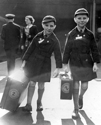 "Oct. 6 1950 b/w file photo of 10 year old twins Brian Thomas Sullivan (left) and Kevin James Sullivan from Islington, London, who carry their luggage to the boat train ""Rangitoto"" as they leave Liverpool Street station in London bound for Auckland, New Zealand. Britain and Australia are saying sorry to thousands of British children who were promised a better life overseas, only to suffer abuse and neglect thousands of miles from home. The British government said Sunday that Prime Minister Gordon Brown will apologize for 20th-century child migrant programs that saw thousands of poor British children sent to Australia, Canada and other former colonies until the 1960s. Many ended up in institutions or were sent to work as farm laborers."