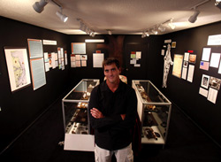 Hatteras Island native Scott Dawson stands in his Hatteras Histories and Mysteries Museum, which he opened in Buxton after the April dig. (L. Todd Spencer | The Virginian-Pilot)