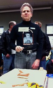 Al Smitley cuts into the cake at his retirement party last Friday.  Photo Credit Steve Fecht