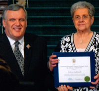 Glencoe Historical Society president JoAnn Galbraith, of Middlemiss, received the Lieutenant Governor s Ontario Heritage Award from David Onley during a ceremony in Toronto on Friday, Feb. 25.