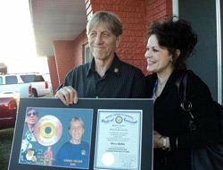 Guitarist Gerry McGee and his wife, Deedee, pose with the plaque McGee received upon his 2011 induction into the Louisiana Music Hall of Fame. / Gannett Louisiana