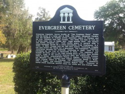 This state historical marker tells what notable people are buried in the Evergreen Cemetery. The site holds about 10,000 graves. Lawrence Chan / WUFT