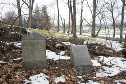 Markers denoting the left and right flanks of the 25th and 75th Ohio regiments sit at the edge of a property on East Cemetery Hill that was recently acquired by the Civil War Trust.