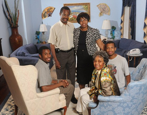 Family: Pictured in 2008, Carson poses in his home with his wife, Lacena 'Candy' Rustin, his two sons and his mother, Sonya Carson (seated at right) – who is actually legally named Johnnie.