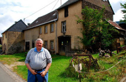 Carl Tiedt standing in front of the home his great-grandparents owned in Bergen, Germany, before they emigrated to America in 1883. He doesn't know why they left.